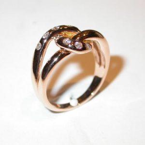 Bague «noeud», or rose, diamants