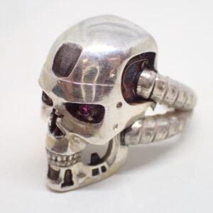 Bague «Terminator» or blanc et rubis