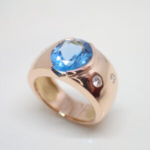 Bague jonc or rose topaze bleue et diamants