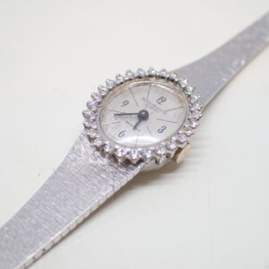 Montre or blanc entourage diamants