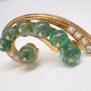 Broche Art Déco or, diamants et boules d'émeraudes